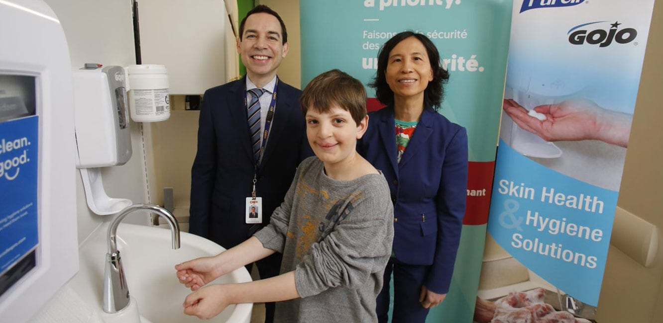 Alex Munter, President and CEO, Children's Hospital of Eastern Ontario and Dr. Theresa Tam, Chief Public Health Officer of Canada celebrate STOP! Clean Your Hands Day with a patient